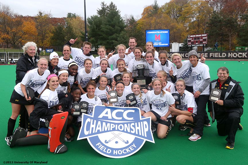 """The University of Maryland field hockey team poses for a photograph after defeating the University of North Carolina to win the ACC Field Hockey Conference Championship game against the University of North Carolina Sunday, November 10, 2013 at Boston College in Newton, Massachusetts."""