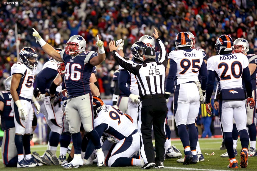 """New England Patriots full back James Develin celebrates after the Patriots scored a touchdown against the Denver Broncos Sunday, November 24, 2013 at Gillette Stadium in Foxborough, Massachusetts."""