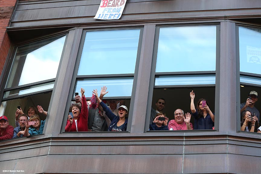 """Fans cheer from windows along Boylston Street during the Rolling Rally World Series Championship Parade through downtown Boston, Massachusetts Saturday, November 2, 2013."""