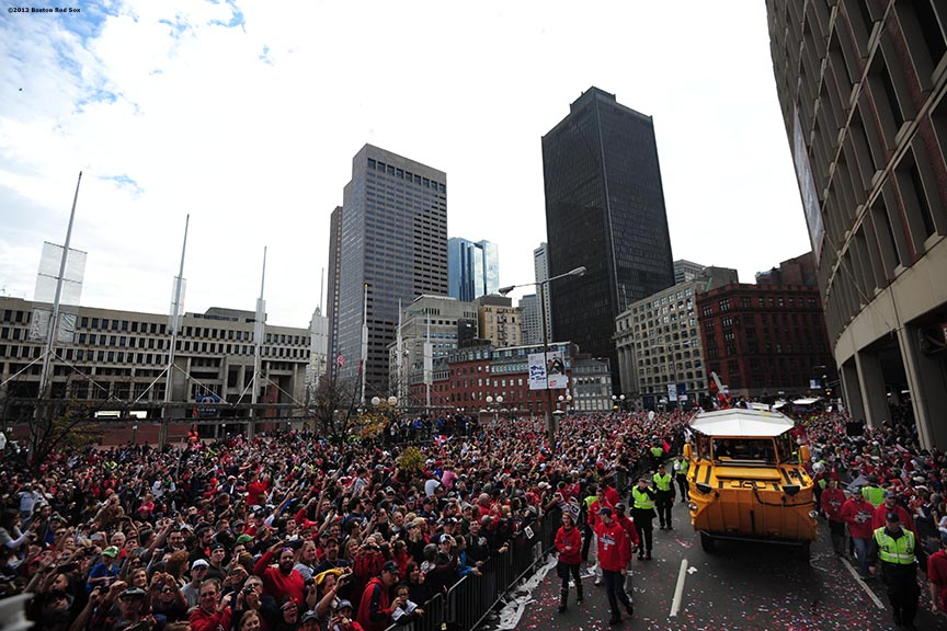 """Fans gathered in City Hall Plaza cheer during the Rolling Rally World Series Championship Parade through downtown Boston, Massachusetts Saturday, November 2, 2013."""