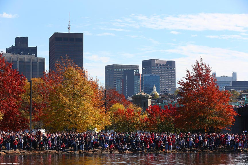 """Fans gathered along the banks of the Charles River cheer during the Rolling Rally World Series Championship Parade through downtown Boston, Massachusetts Saturday, November 2, 2013."""