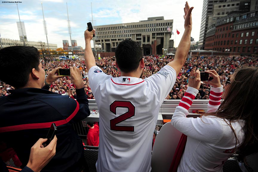 """Boston Red Sox center fielder Jacoby Ellsbury waves to fans during the Rolling Rally World Series Championship Parade through downtown Boston, Massachusetts Saturday, November 2, 2013."""