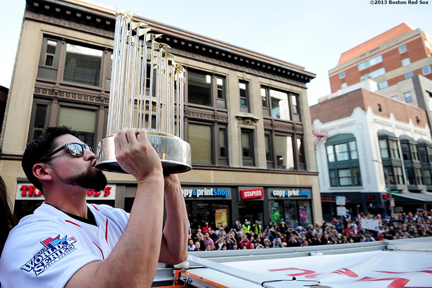 """Boston Red Sox center fielder Jacoby Ellsbury kisses the World Series trophy during the Rolling Rally World Series Championship Parade through downtown Boston, Massachusetts Saturday, November 2, 2013."""