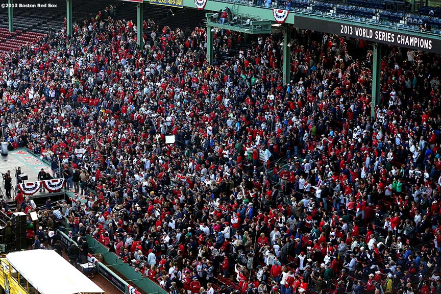 """Boston Red Sox fans gather at Fenway Park before the Rolling Rally World Series Championship Parade through downtown Boston, Massachusetts Saturday, November 2, 2013."""