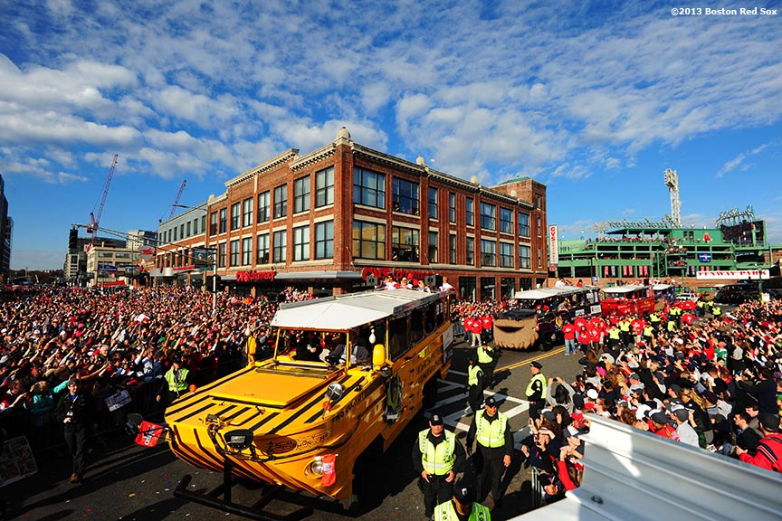 """Fans cheer as duck boats turn onto Boylston Street during the Rolling Rally World Series Championship Parade through downtown Boston, Massachusetts Saturday, November 2, 2013."""