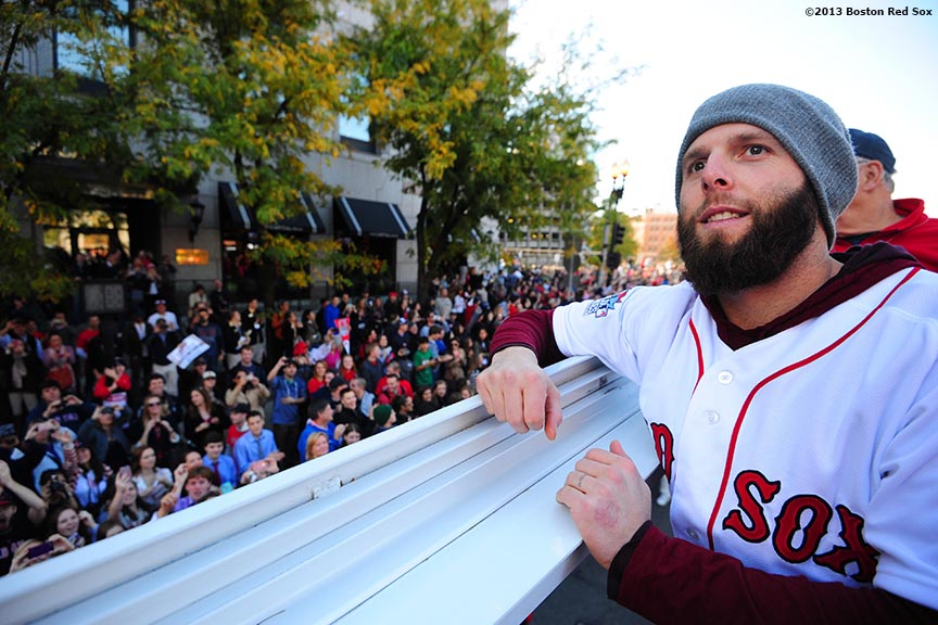 """Boston Red Sox second baseman Dustin Pedroia waves to fans during the Rolling Rally World Series Championship Parade through downtown Boston, Massachusetts Saturday, November 2, 2013."""