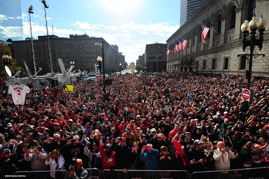 """Fans in Copley Square cheer during the Rolling Rally World Series Championship Parade through downtown Boston, Massachusetts Saturday, November 2, 2013."""