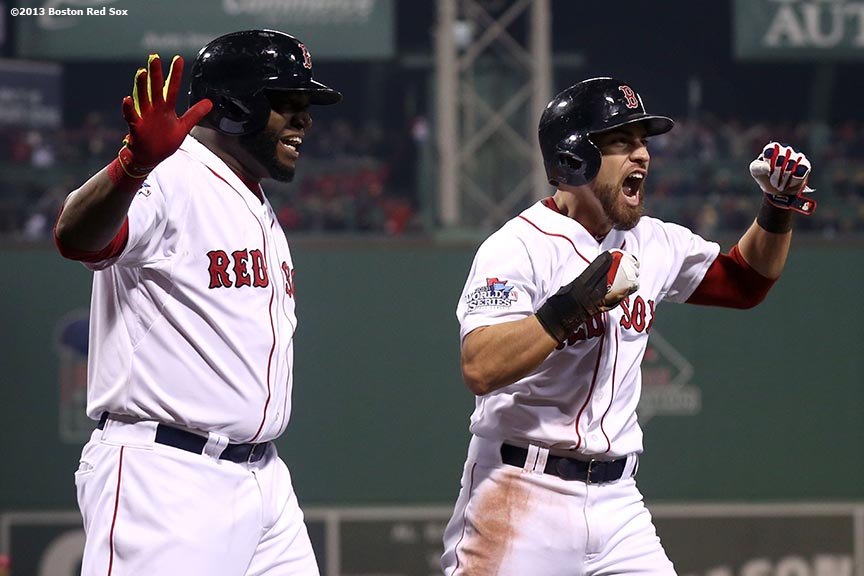 """Boston Red Sox designated hitter David Ortiz and center fielder Jacoby Ellsbury react after scoring on an RBI double by right fielder Shane Victorino during the third inning of game six of the 2013 World Series against the St. Louis Cardinals  Wednesday, October 30, 2013 at Fenway Park in Boston, Massachusetts."""