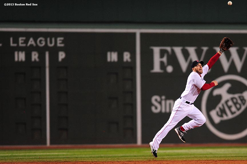 """ Boston Red Sox shortstop Stephen Drew lunges for a ball during the third inning of game six of the 2013 World Series against the St. Louis Cardinals Wednesday, October 30, 2013 at Fenway Park in Boston, Massachusetts."""