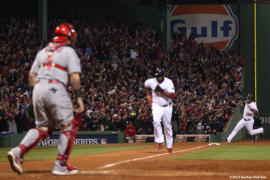 """Boston Red Sox first baseman Mike Napoli and designated hitter David Ortiz score on an RBI single by right fielder Shane Victorino during the fourth inning of game six of the 2013 World Series against the St. Louis Cardinals Wednesday, October 30, 2013 at Fenway Park in Boston, Massachusetts."""