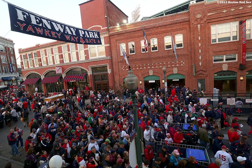"""Fans gather on Yawkey Way before game six of the 2013 World Series between the Boston Red Sox and the St. Louis Cardinals Wednesday, October 30, 2013 at Fenway Park in Boston, Massachusetts."""