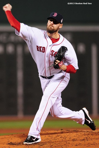 """Boston Red Sox pitcher John Lackey delivers during the first inning of game six of the 2013 World Series against the St. Louis Cardinals Wednesday, October 30, 2013 at Fenway Park in Boston, Massachusetts."""