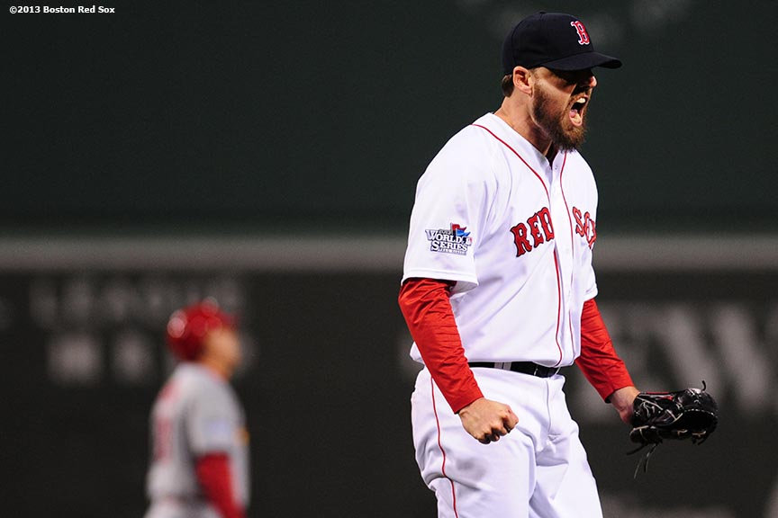 """Boston Red Sox pitcher John Lackey reacts after the fourth inning of game six of the 2013 World Series against the St. Louis Cardinals Wednesday, October 30, 2013 at Fenway Park in Boston, Massachusetts."""