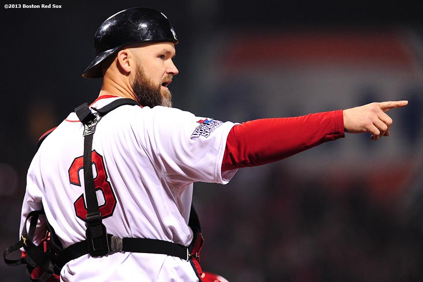 """Boston Red Sox catcher David Ross points during the first inning of game six of the 2013 World Series against the St. Louis Cardinals Wednesday, October 30, 2013 at Fenway Park in Boston, Massachusetts."""
