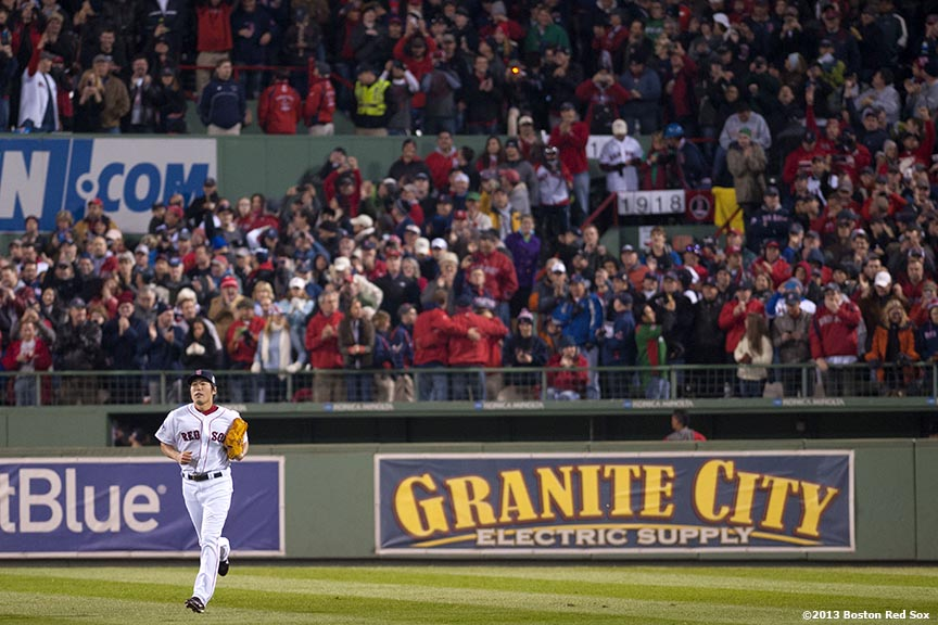 """Boston Red Sox pitcher Koji Uehara jogs from the bullpen during the ninth inning of game six of the 2013 World Series against the St. Louis Cardinals Wednesday, October 30, 2013 at Fenway Park in Boston, Massachusetts."""