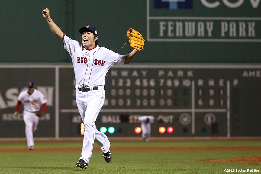 """Boston Red Sox pitcher Koji Uehara reacts after recording the final out to defeat the St. Louis Cardinals 6-1 to win the 2013 World Series Wednesday, October 30, 2013 at Fenway Park in Boston, Massachusetts."""