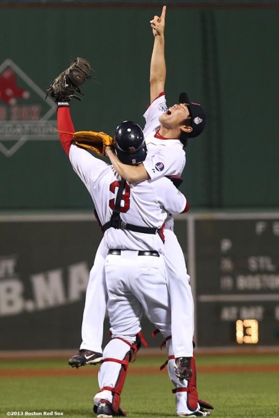"""Boston Red Sox pitcher Koji Uehara and catcher David Ross react after recording the final out to defeat the St. Louis Cardinals 6-1 to win the 2013 World Series Wednesday, October 30, 2013 at Fenway Park in Boston, Massachusetts."""
