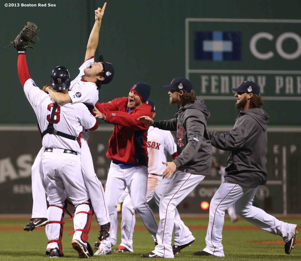 """Boston Red Sox pitcher Koji Uehara, catcher David Ross, and teammates react after recording the final out to defeat the St. Louis Cardinals 6-1 to win the 2013 World Series Wednesday, October 30, 2013 at Fenway Park in Boston, Massachusetts."""