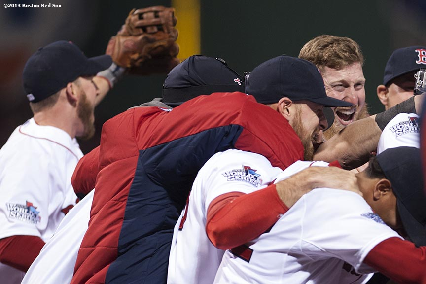 """Boston Red Sox players celebrate after defeating the St. Louis Cardinals 6-1 to win the 2013 World Series Wednesday, October 30, 2013 at Fenway Park in Boston, Massachusetts."""