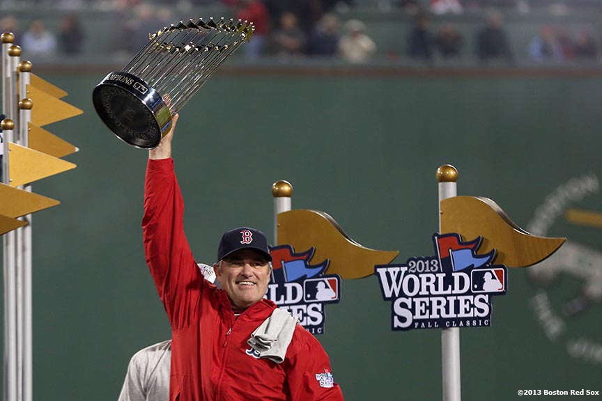 """Boston Red Sox manager John Farrell raises the World Series trophy  after defeating the St. Louis Cardinals 6-1 to win the 2013 World Series Wednesday, October 30, 2013 at Fenway Park in Boston, Massachusetts."""