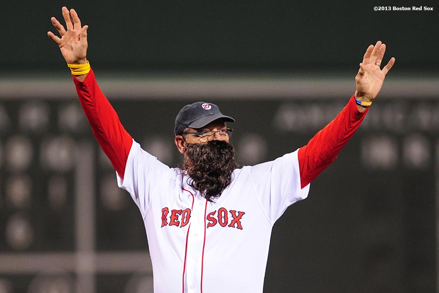 """Former Boston Red Sox player Carlton Fisk wears a beard while throwing out the ceremonial first pitch during a pre-game ceremony before game six of the 2013 World Series between the Boston Red Sox and the St. Louis Cardinals Wednesday, October 30, 2013 at Fenway Park in Boston, Massachusetts."""