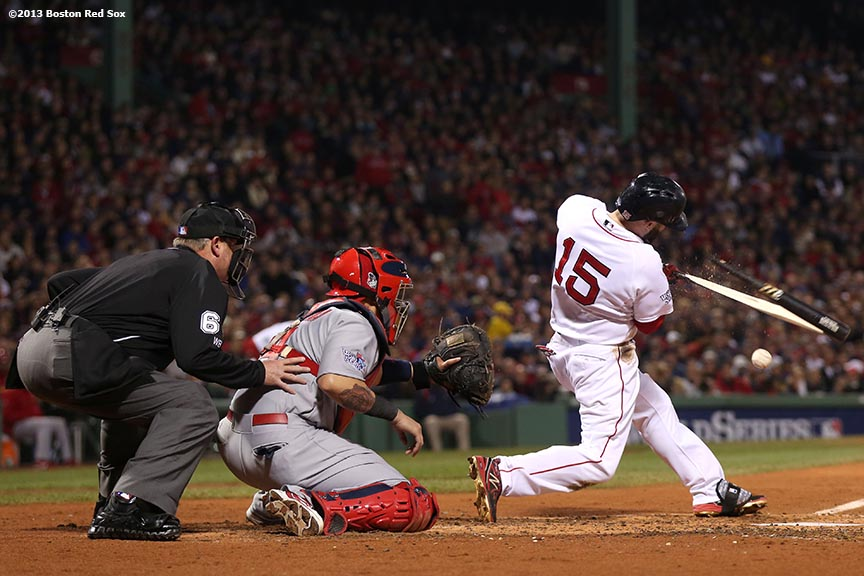 """Boston Red Sox second baseman Dustin Pedroia breaks his bat during the third inning of game six of the 2013 World Series against the St. Louis Cardinals Wednesday, October 30, 2013 at Fenway Park in Boston, Massachusetts."""