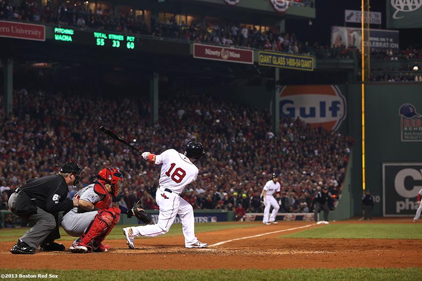 """Boston Red Sox right fielder Shane Victorino hits a three-RBI double during the third inning of game six of the 2013 World Series against the St. Louis Cardinals Wednesday, October 30, 2013 at Fenway Park in Boston, Massachusetts."""