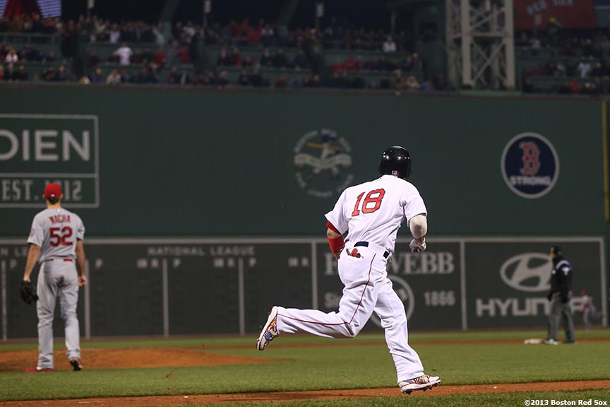 """Boston Red Sox right fielder Shane Victorino rounds the bases after hitting a three-RBI double during the third inning of game six of the 2013 World Series against the St. Louis Cardinals Wednesday, October 30, 2013 at Fenway Park in Boston, Massachusetts."""