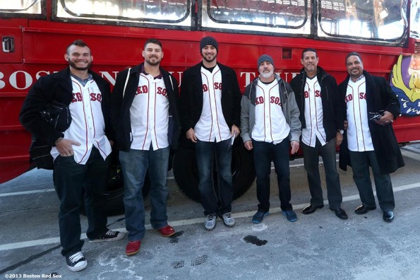 """Boston Red Sox players and coaches pose for a photograph outside a Duck Tour boat in Boston, Massachusetts Thursday, December 12, 2013 as part of the Red Sox Holiday Caravan to various locations throughout Boston."""