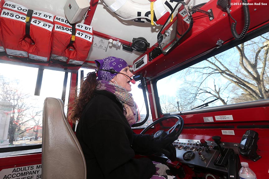 """Boston Duck Boat driver 'Flo' drives Boston Red Sox players and coaches through Boston, Massachusetts Thursday, December 12, 2013 as part of the Red Sox Holiday Caravan to various locations throughout Boston."""