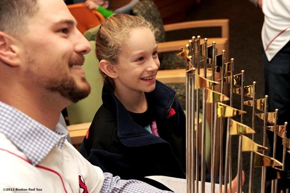 """Boston Red Sox catcher Ryan Lavarnway poses with a patient and the World Series trophy during a visit to The Jimmy Fund at Dana-Farber Cancer Institute in Boston, Massachusetts Friday, December 13, 2013 as part of the Red Sox Holiday Caravan to various locations throughout Boston."""
