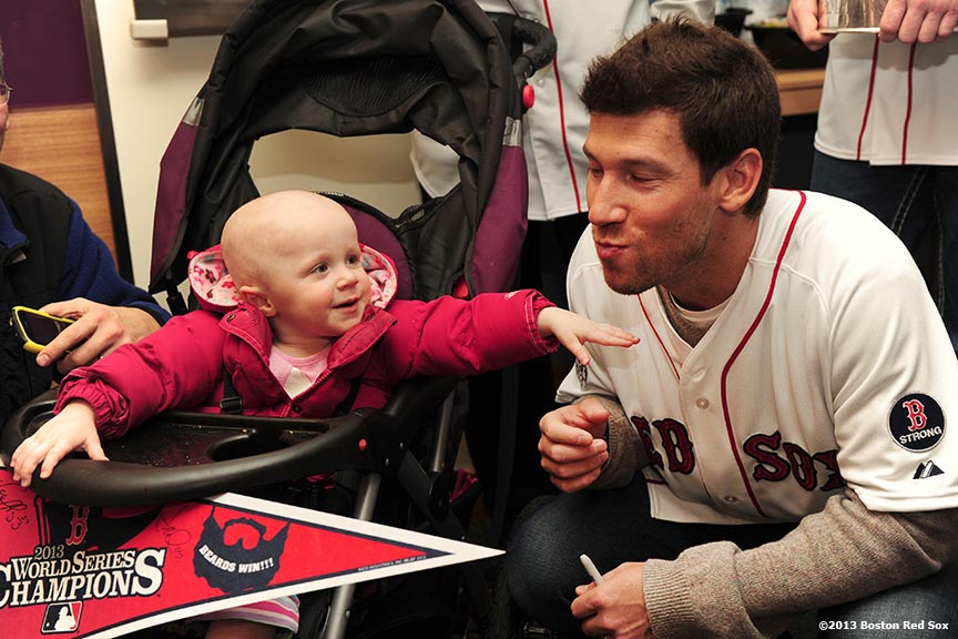 """Scarlett Rohnke, a two and a half year-old patient at The Jimmy Fund, plays with Boston Red Sox pitcher Craig Breslow during a visit to The Jimmy Fund at Dana-Farber Cancer Institute in Boston, Massachusetts Friday, December 13, 2013 as part of the Red Sox Holiday Caravan to various locations throughout Boston."""