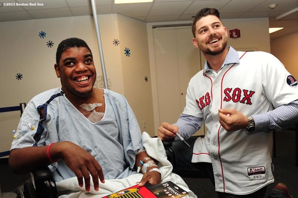 """Boston Red Sox catcher Ryan Lavarnway shares a laugh with a patient during a visit to Boston Children's Hospital Friday, December 13, 2013 as part of the Red Sox Holiday Caravan."""