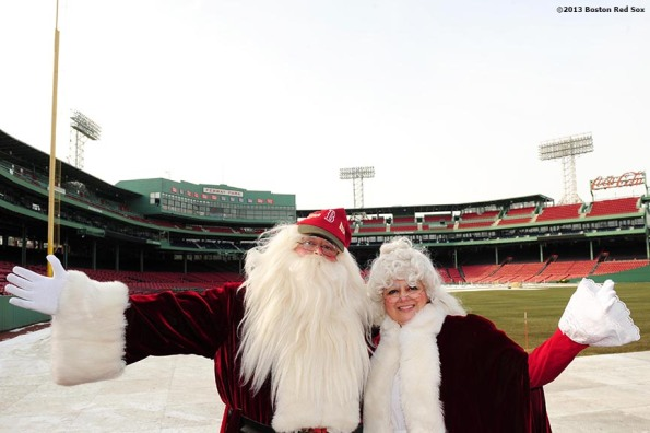 """Santa Claus and Mrs. Claus pose for a photograph during the annual Christmas at Fenway celebration Saturday, December 14, 2013, which featured speaking appearances and autograph sessions with players and coaches, holiday themed attractions and decorations, and opportunities for fans to purchase tickets for the 2014 season."""