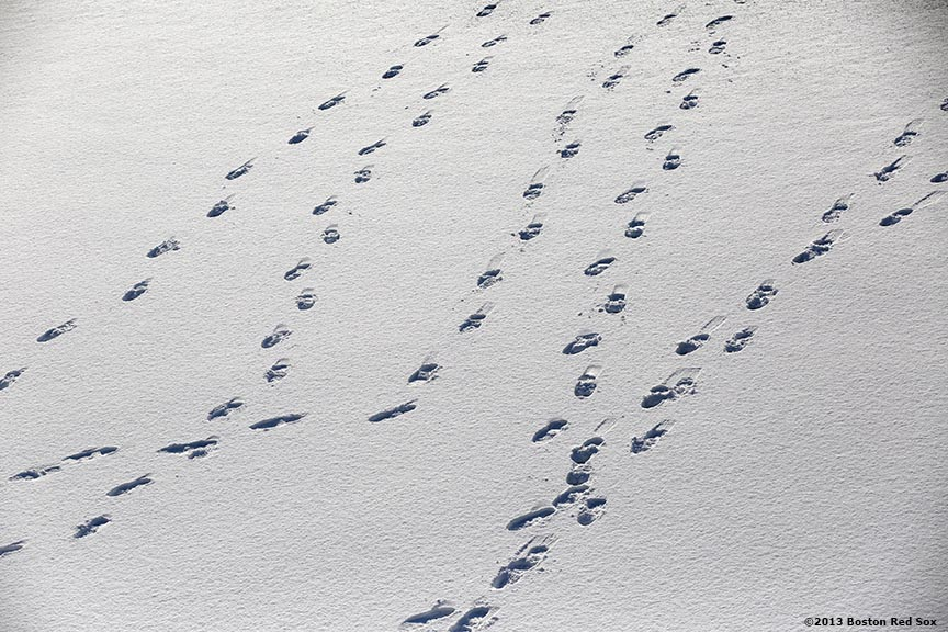 """""""Footprints are shown on the snowy outfield grass before the first day of Frozen Fenway 2014 at Fenway Park in Boston, Massachusetts Friday, December 27, 2013."""""""