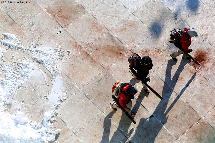 """""""Workers blow snow off of the field before the first day of Frozen Fenway 2014 at Fenway Park in Boston, Massachusetts Friday, December 27, 2013."""""""