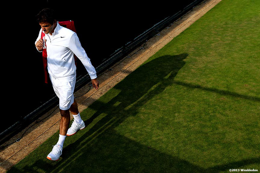 """Roger Federer walks off the Aorangi practice courts at the All England Lawn and Tennis Club in London, England Tuesday, June 25, 2013 during the 2013 Championships Wimbledon."""
