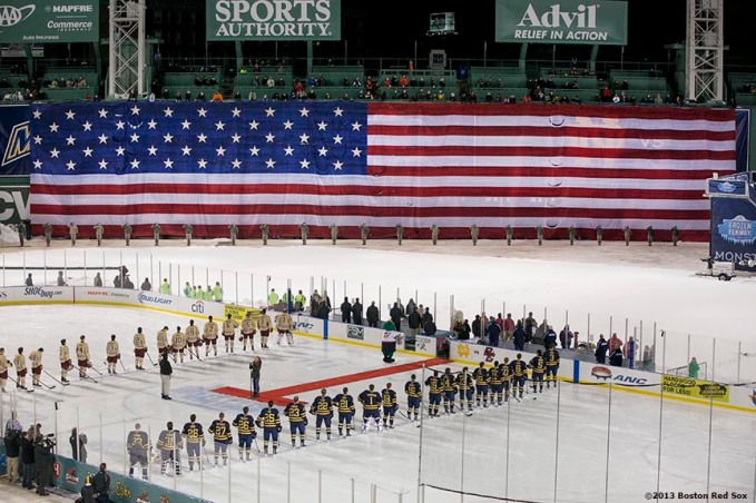 """Starting lineups are introduced before a game between Boston College and Notre Dame at Frozen Fenway Saturday, January 4, 2014 at Fenway Park in Boston, Massachusetts."""