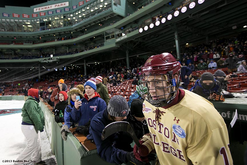 """A member of the Boston College hockey team enters the field before a game against Notre Dame at Frozen Fenway Saturday, January 4, 2014 at Fenway Park in Boston, Massachusetts."""