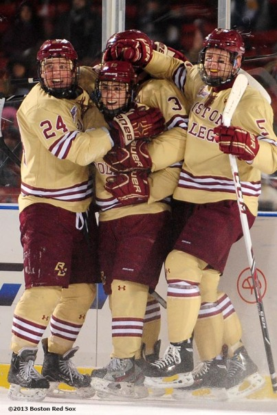"""Boston College celebrates after scoring a goal during a game against Notre Dame at Frozen Fenway Saturday, January 4, 2014 at Fenway Park in Boston, Massachusetts."""