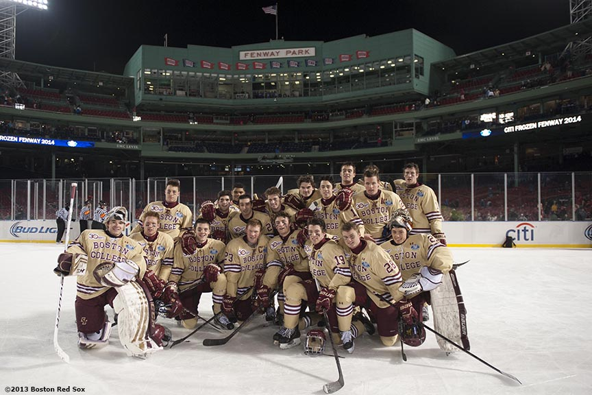"""The Boston College hockey team poses for a group photograph after player Notre Dame at Frozen Fenway Saturday, January 4, 2014 at Fenway Park in Boston, Massachusetts."""