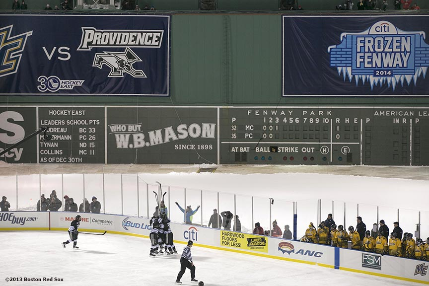 """Providence College celebrates after scoring a goal during the third period of a game against Merrimack College at Frozen Fenway Saturday, January 4, 2014 at Fenway Park in Boston, Massachusetts."""