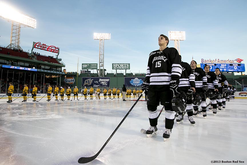 """Starting lineups are introduced before a game between Providence College and Merrimack College at Frozen Fenway Saturday, January 4, 2014 at Fenway Park in Boston, Massachusetts."""