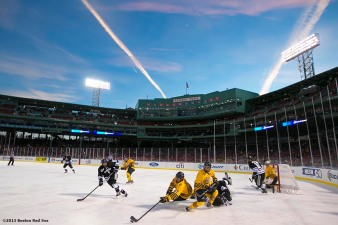 """Providence College and Merrimack College play each other in the first period of a game at Frozen Fenway Saturday, January 4, 2014 at Fenway Park in Boston, Massachusetts."""