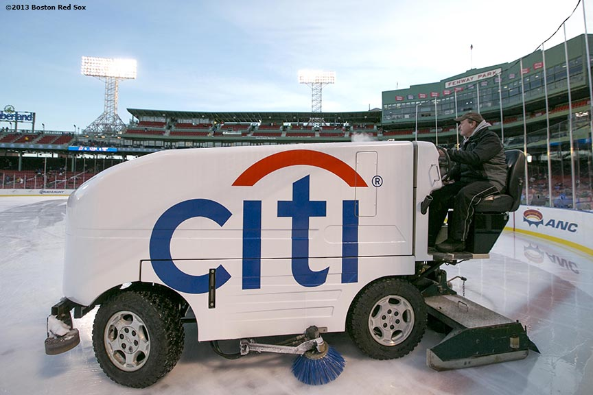 """A zamboni operator prepares the ice before a game between Providence College and Merrimack College at Frozen Fenway Saturday, January 4, 2014 at Fenway Park in Boston, Massachusetts."""