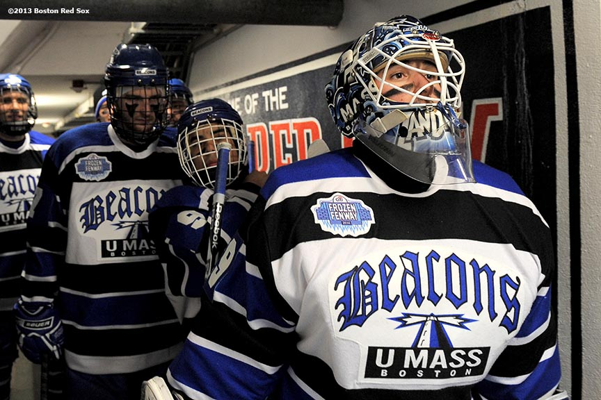 """University of Massachusetts players wait in the Red Sox dugout tunnel before a game against Salem State at Frozen Fenway Tuesday, January 7, 2014 at Fenway Park in Boston, Massachusetts."""