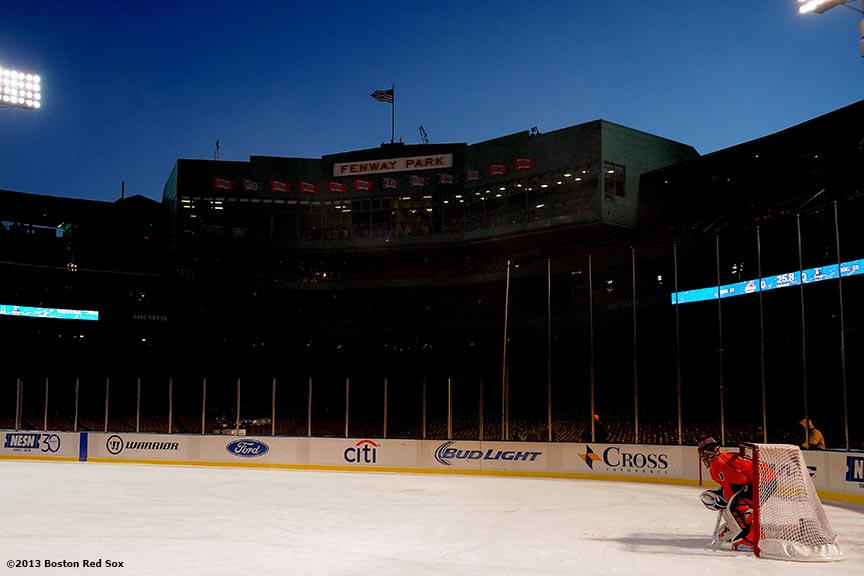 """The Salem State goalie waits in the net during a game against the University of Massachusetts at Frozen Fenway Tuesday, January 7, 2014 at Fenway Park in Boston, Massachusetts."""