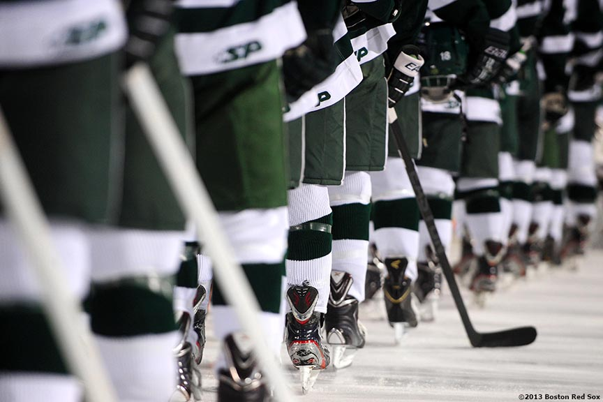 """Babson College players line up on the ice before a game against Norwich University at Frozen Fenway Thursday, January 9, 2014 at Fenway Park in Boston, Massachusetts."""