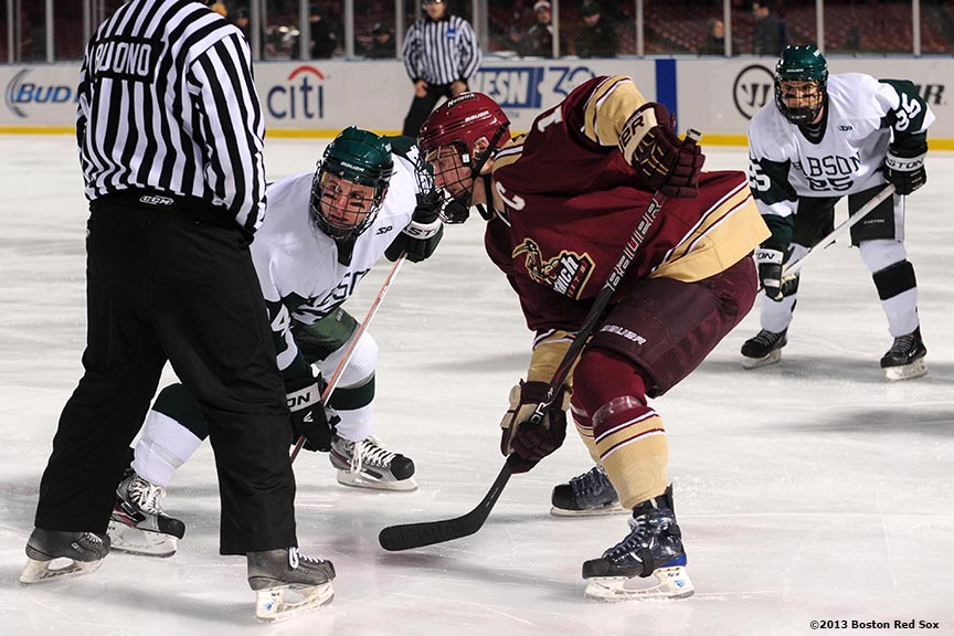 """Game action during a game between Babson College and Norwich University at Frozen Fenway Thursday, January 9, 2014 at Fenway Park in Boston, Massachusetts."""