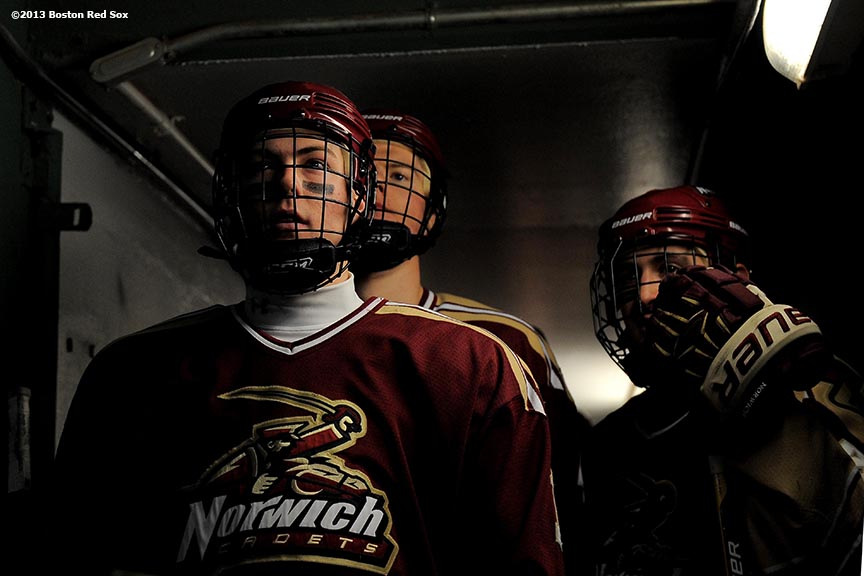 """Norwich University players wait in the dugout tunnel before a game against Babson College at Frozen Fenway Thursday, January 9, 2014 at Fenway Park in Boston, Massachusetts."""